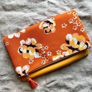 Rachel Pally pumpkin + marigold floral clutch
